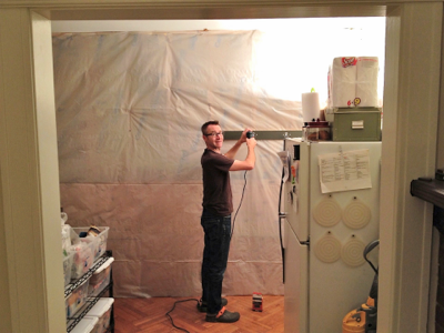 john-installing-coat rack