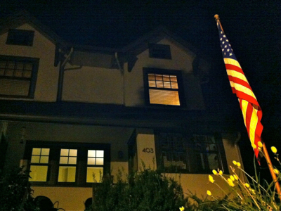 house-with-flag-at-night