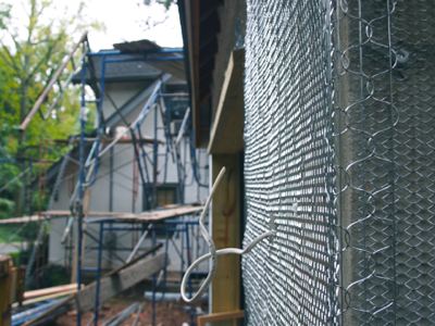 wire-mesh-around-house