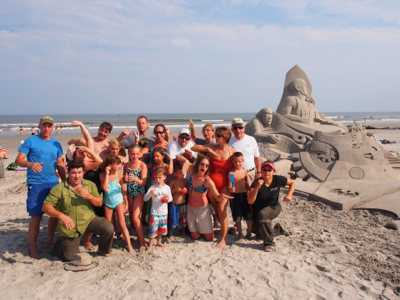 group-photo-with-sand-castle