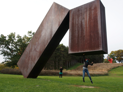 jumping-under-sculpture
