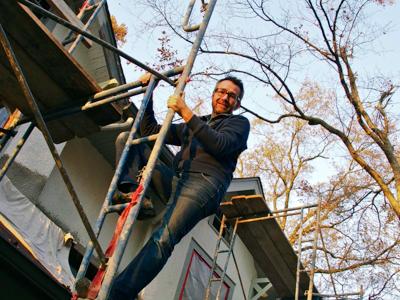 john-climbing-ladder