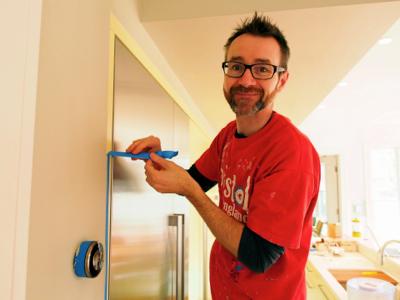 john-using-blue-tape