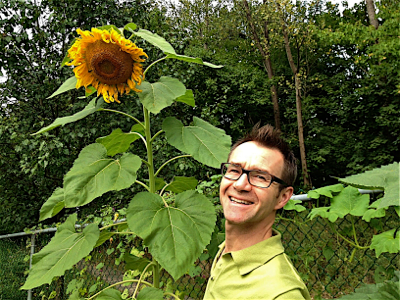john-and-sunflower-in-his-garden